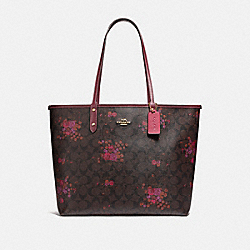 COACH F37807 - REVERSIBLE CITY TOTE IN SIGNATURE CANVAS WITH FLORAL BUNDLE PRINT BROWN/METALLIC CURRANT/LIGHT GOLD