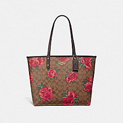 REVERSIBLE CITY TOTE IN SIGNATURE CANVAS WITH JUMBO FLORAL PRINT - F37844 - KHAKI/OXBLOOD MULTI/LIGHT GOLD