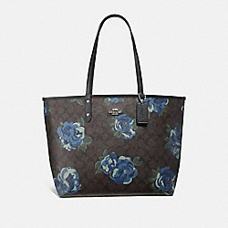 REVERSIBLE CITY TOTE IN SIGNATURE CANVAS WITH JUMBO FLORAL PRINT - F37844 - BROWN BLACK/MULTI/SILVER