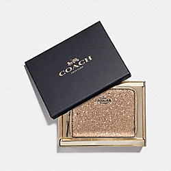 COACH F38693 - BOXED SMALL ZIP AROUND WALLET WITH STAR GLITTER GOLD/SILVER