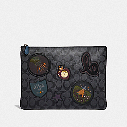 COACH F39702 Large Pouch In Signature Canvas With Wizard Of Oz Patches CHARCOAL MULTI/BLACK ANTIQUE NICKEL