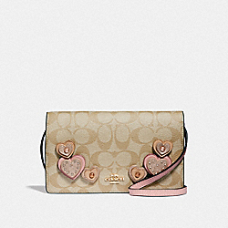 HAYDEN FOLDOVER CROSSBODY CLUTCH IN SIGNATURE CANVAS WITH HEART APPLIQUE - F55612 - KHAKI MULTI /IMITATION GOLD
