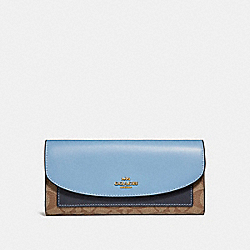 SLIM ENVELOPE WALLET IN COLORBLOCK SIGNATURE CANVAS - f56494 - KHAKI/MIDNIGHT POOL/LIGHT GOLD