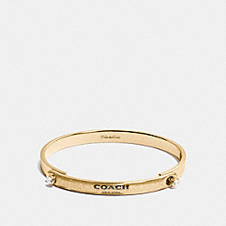 COACH GLITTER COACH STONE TENSION BANGLE - GOLD - F56783