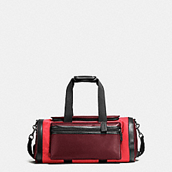 COACH TERRAIN GYM BAG IN PERFORATED MIXED MATERIALS - BRICK RED/BRIGHT RED - F56875
