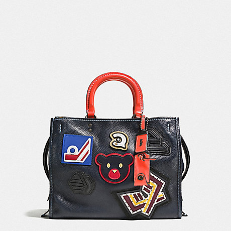 COACH F57231 ROGUE WITH VARSITY PATCHES BP/NAVY