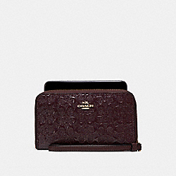 PHONE WALLET IN SIGNATURE DEBOSSED PATENT LEATHER - f57469 - LIGHT GOLD/OXBLOOD 1