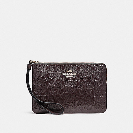 01fe8f3858265 COACH f58034 CORNER ZIP WRISTLET IN SIGNATURE DEBOSSED PATENT LEATHER LIGHT  GOLD OXBLOOD 1