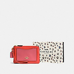 COACH F58364 - BOXED SMALL WRISTLET IN COLORBLOCK LI/DEEP CORAL PEONY