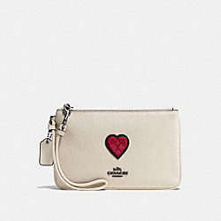 SMALL WRISTLET WITH SOUVENIR EMBROIDERY - F58856 - DK/CHALK