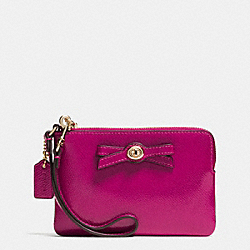 COACH F64648 Turnlock Bow Corner Zip Wristlet In Patent Leather IMITATION GOLD/CRANBERRY