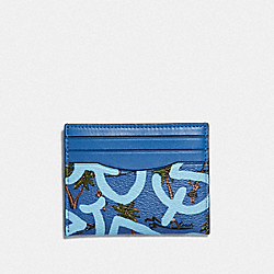 KEITH HARING SLIM ID CARD CASE WITH HULA DANCE PRINT - F66579 - SKY BLUE MULTI/BLACK ANTIQUE NICKEL