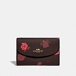 KEY CASE WITH TOSSED PEONY PRINT - F67524 - OXBLOOD 1 MULTI/GOLD