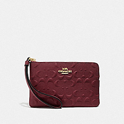 COACH F67555 - CORNER ZIP WRISTLET IN SIGNATURE LEATHER WINE/IMITATION GOLD