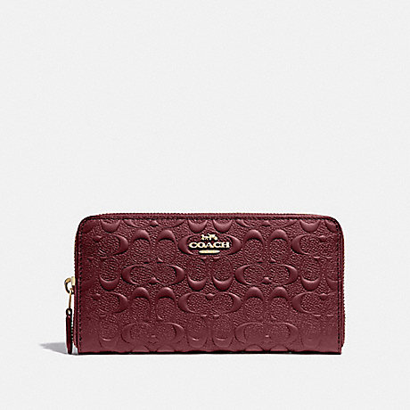 COACH F67566 ACCORDION ZIP WALLET IN SIGNATURE LEATHER WINE/IMITATION GOLD