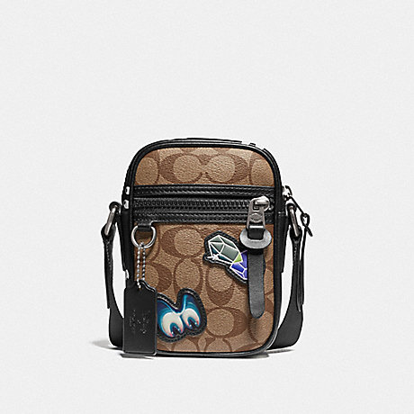 well known look for new product COACH F72951 - DISNEY X COACH TERRAIN CROSSBODY IN SIGNATURE ...