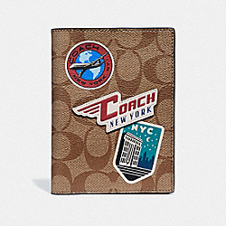 COACH F73083 - PASSPORT CASE IN SIGNATURE CANVAS WITH TRAVEL PATCHES KHAKI/MULTI