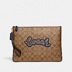 COACH F73153 - LARGE WRISTLET 30 IN SIGNATURE CANVAS WITH COACH PRINT KHAKI MULTI /IMITATION GOLD
