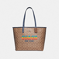 REVERSIBLE CITY TOTE IN SIGNATURE CANVAS WITH RAINBOW COACH ANIMATION - F73324 - KHAKI/DENIM/SILVER