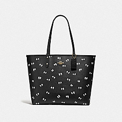 DISNEY X COACH REVERSIBLE CITY TOTE IN SIGNATURE CANVAS AND SNOW WHITE AND THE SEVEN DWARFS EYES PRINT - F73325 - MULTI
