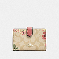 MEDIUM CORNER ZIP WALLET IN SIGNATURE CANVAS WITH LILY PRINT - F73374 - LIGHT KHAKI/PINK MULTI/GOLD