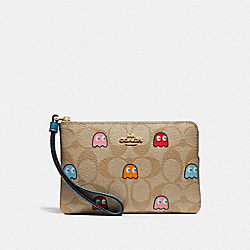 CORNER ZIP WRISTLET IN SIGNATURE CANVAS WITH PAC-MAN GHOSTS PRINT - F73387 - LIGHT KHAKI MULTI/GOLD