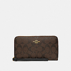 COACH F73418 - LARGE PHONE WALLET IN SIGNATURE CANVAS BROWN/BLACK/IMITATION GOLD