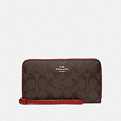 COACH F73418 - LARGE PHONE WALLET IN SIGNATURE CANVAS IM/BROWN TRUE RED