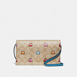 HAYDEN FOLDOVER CROSSBODY CLUTCH IN SIGNATURE CANVAS WITH PAC-MAN GHOSTS PRINT - F73447 - LIGHT KHAKI MULTI/GOLD