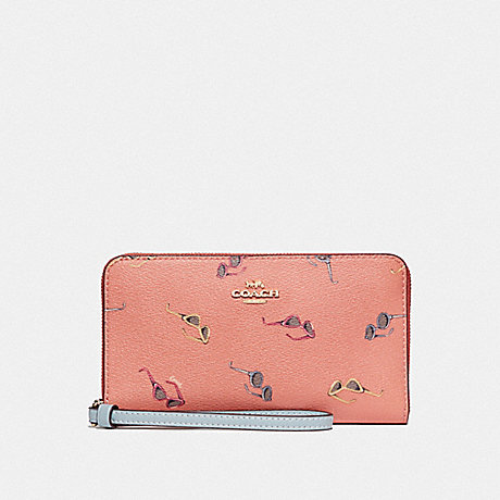 COACH LARGE PHONE WALLET WITH SUNGLASSES PRINT - LIGHT CORAL/MULTI/GOLD - F73455