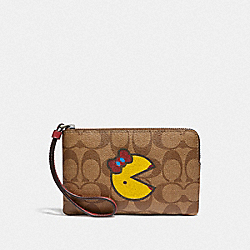CORNER ZIP WRISTLET IN SIGNATURE CANVAS WITH MS. PAC-MAN - F75594 - KHAKI MULTI/SILVER