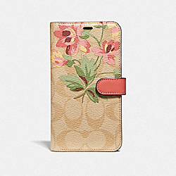 COACH F75843 - IPHONE XR FOLIO IN SIGNATURE CANVAS WITH LILY BOUQUET PRINT LIGHT KHAKI/PINK