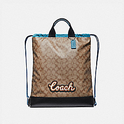 COACH F76792 - TERRAIN DRAWSTRING BACKPACK IN SIGNATURE CANVAS WITH COACH SCRIPT TAN/BLACK ANTIQUE NICKEL