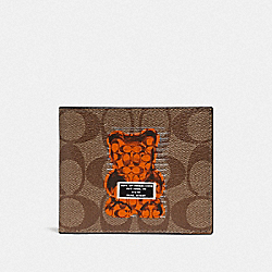 COACH F76857 - ID BILLFOLD WALLET IN SIGNATURE CANVAS WITH VANDAL GUMMY TAN/BLACK ANTIQUE NICKEL
