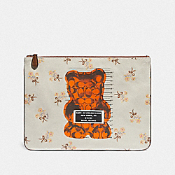 COACH F76933 - LARGE WRISTLET 30 WITH VANDAL GUMMY CHALK MULTI/BLACK ANTIQUE NICKEL