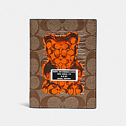 COACH F77914 - PASSPORT CASE IN SIGNATURE CANVAS WITH VANDAL GUMMY TAN/BLACK ANTIQUE NICKEL