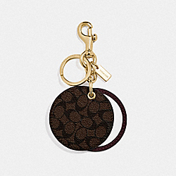 COACH F77961 - MIRROR BAG CHARM IN SIGNATURE CANVAS GD/MAHOGANY