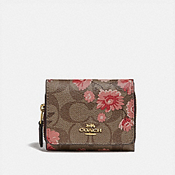 COACH F78022 - SMALL TRIFOLD WALLET IN SIGNATURE CANVAS WITH PRAIRIE DAISY CLUSTER PRINT KHAKI CORAL MULTI/IMITATION GOLD