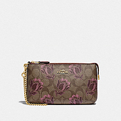 COACH F78112 - LARGE WRISTLET IN SIGNATURE CANVAS WITH DESERT TULIP PRINT IM/KHAKI PINK MULTI