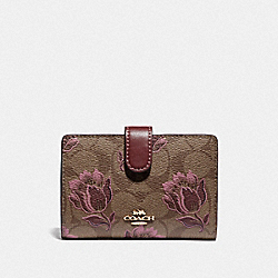 COACH F78118 Medium Corner Zip Wallet In Signature Canvas With Desert Tulip Print IM/KHAKI PINK MULTI