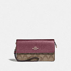 COACH F78229 - FOLDOVER WRISTLET IN SIGNATURE CANVAS IM/KHAKI METALLIC WINE