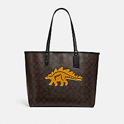 REVERSIBLE CITY TOTE IN SIGNATURE CANVAS WITH DINOSAUR MOTIF - F78255 - QB/BROWN BLACK MULTI