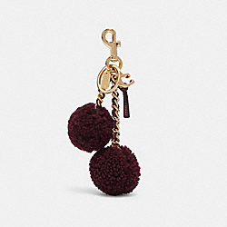 POM POM BAG CHARM - F78516 - GD/DARK BERRY