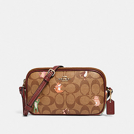 COACH CROSSBODY POUCH IN SIGNATURE CANVAS WITH PARTY ANIMALS PRINT - IM/KHAKI PINK MULTI - F87850