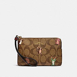 COACH F87877 Corner Zip Wristlet In Signature Canvas With Party Animals Print IM/KHAKI PINK MULTI