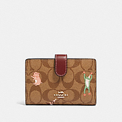 COACH F87911 Medium Corner Zip Wallet In Signature Canvas With Party Animals Print IM/KHAKI PINK MULTI