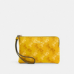 COACH F88083 - CORNER ZIP WRISTLET WITH HORSE AND CARRIAGE PRINT SV/YELLOW MULTI