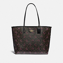REVERSIBLE CITY TOTE IN SIGNATURE CANVAS WITH MOON PRINT - F89155 - IM/BROWN PURPLE MULTI/BLACK