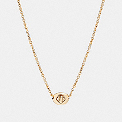 COACH SHORT TURNLOCK NECKLACE - GOLD - F90337