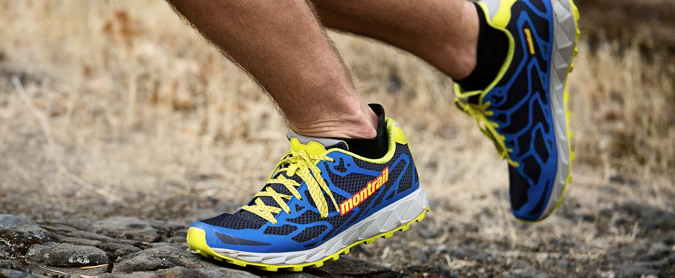 A runner wearing the Rogue F.K.T. on a rugged looking trail- ankle down shot.